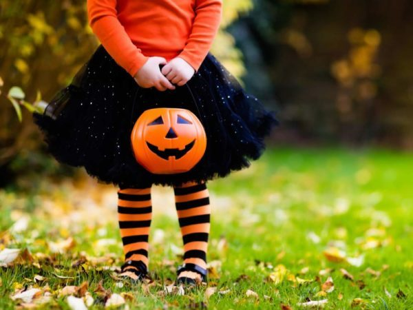 Young girl trick-or-treating