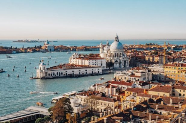 Panoramic aerial view of Venice from San Marco Campanile. Grand canal, Basilica Santa Maria della Salute. Italy