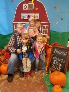 RAYMOND BELL with grandkids