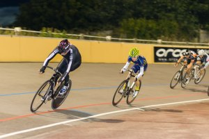 Gawain Bailey of Performance Cycles leads out the Unknown Distance pursued by winner Joseph Crolla of AW Cycles