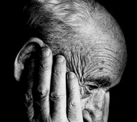 old man looking despondent