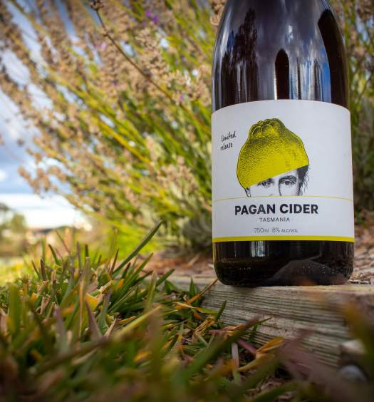 Pagan Quince Cider Bottle in the garden