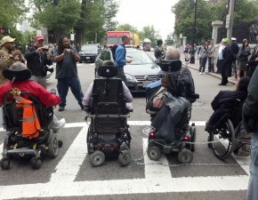 Protesters Chain Wheelchairs Together & Halt Traffic in Beacon Hill to Fight MBTA Fare Hikes