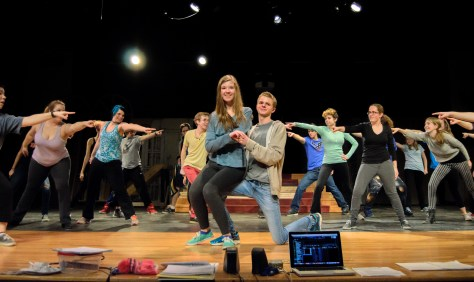 "Chloe Horner, as Sandy Dumbrowski, and Cutter Mendenhall, as Danny Zuko (center) rehearse ""You're the One That I Want"" with the T-Birds, Pink Ladies, and other Rydell High students in Western Albemarle's production of ""Grease,"" opening March 17 2016"