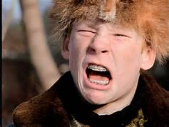 Andy Dalton's expression as the pass rush closes in...