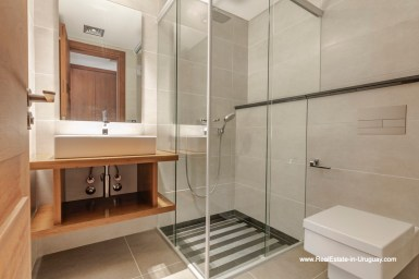 Guest Bathroom of High-Tech State of the Art and Modern Estate on the Brava Beach in Punta del Este with a large Garden
