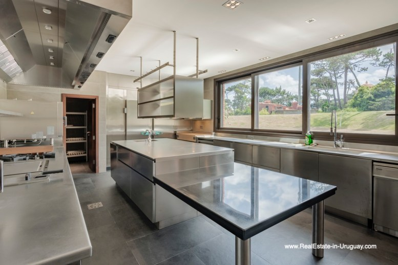 Kitchen with View of High-Tech State of the Art and Modern Estate on the Brava Beach in Punta del Este with a large Garden