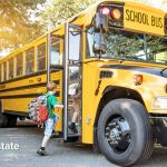 kids going to school using the school bus
