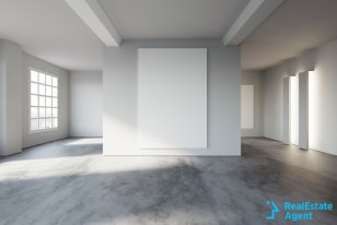 huge empty living room with many big windows having a decoration wall in center