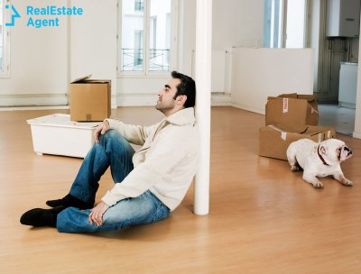 man moving with his pet due to foreclosure