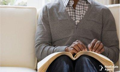 blind man reading braille book