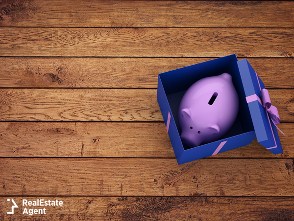 piggy bank wrapped in a present box