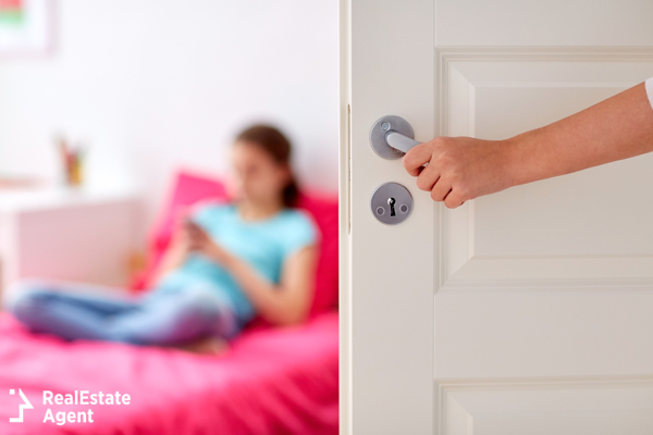 mom entering her teenage daughter's room without knocking at the door