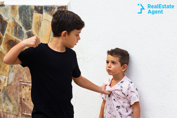 a bigger kids bullying another younger one