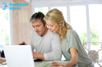 mature couple with laptop and map
