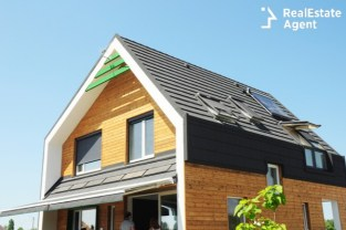 modern house building with energy solar panel