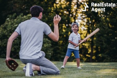 handsome dad with little kid playing baseball