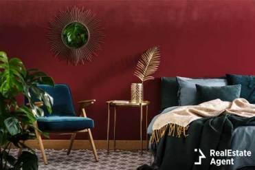 gold table between green armchair