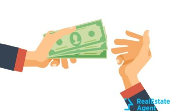 hand holds cash money