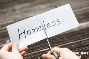 hold card with homeless text