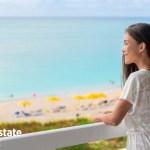happy asian woman tourist enjoying ocean view