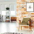 rustic furniture on brick wall