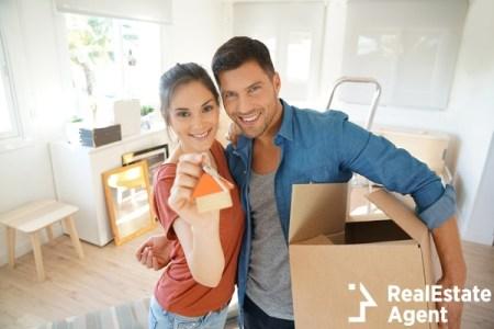 Happy couple showing keys