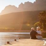 Senior couple sitting on pier