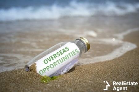 overseas opportunities written on paper in a bottle washed ashore