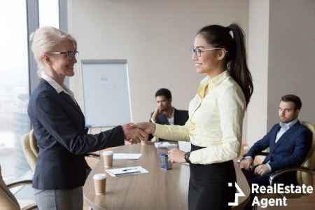Smiling middle aged businesswoman handshake