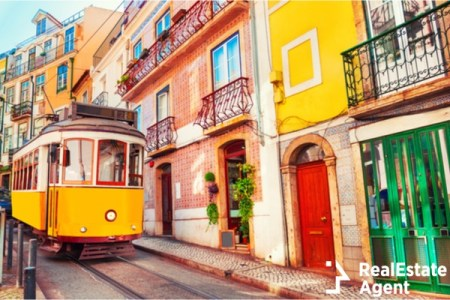 yellow vintage tram on the streets in portugal