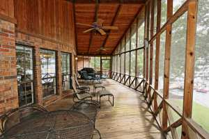 Large screened porch on this home for sale in the Real Island area of Lake Martin