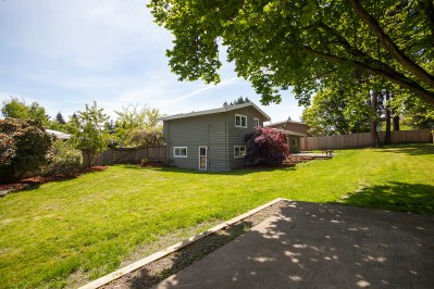 house-backyard Laurie Way Announces | Des Moines Multi-Level Home with Large Yard!