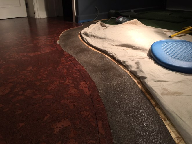 A great sand / epoxy solution for the transition from the rest of his room into his GOLF SIMULATOR space.
