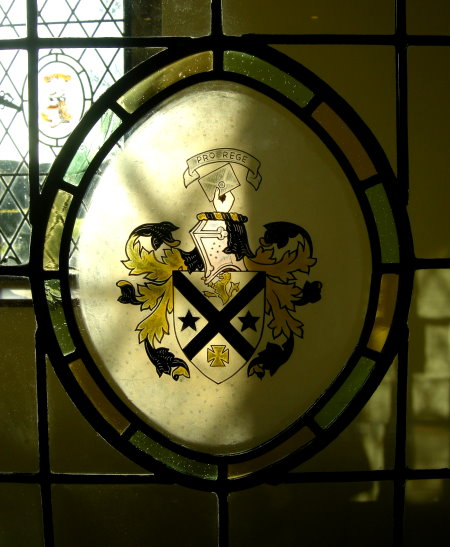 The heraldic crest of Hampton Hall