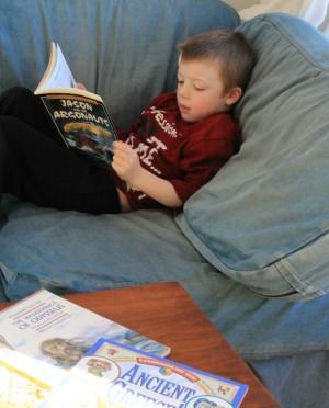 boy reading Greek Myths