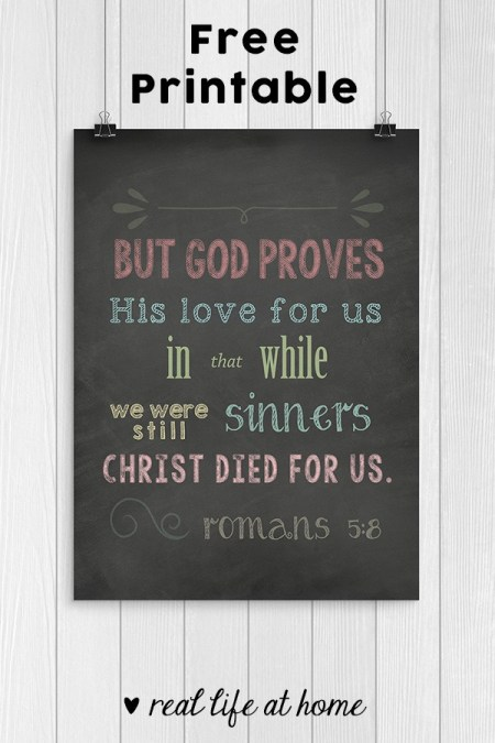 Free Printable: A chalkboard style Scripture art print download featuring the Bible verse from Romans 5:8 reminding us of God's great love for us. | Real Life at Home
