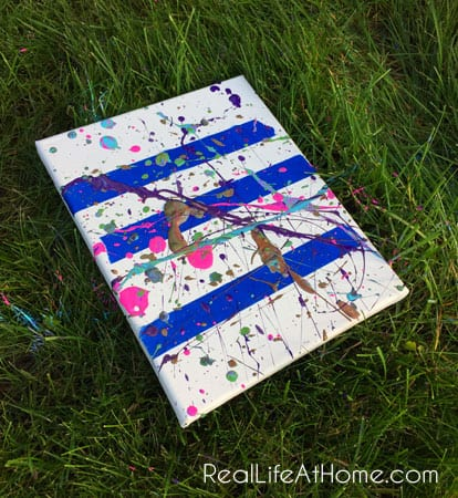 Outdoor splatter painting activity using painters tape