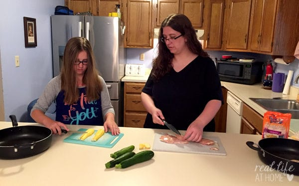 Making meals with your kids doesn't have to be stressful! Family meal prepping can speed up the process and be fun!