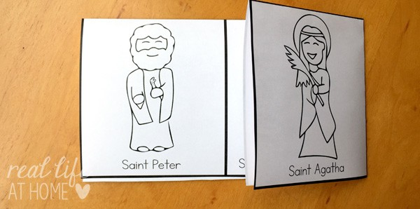 Folding the All Saints' Day Coloring Page to form an All Saints' Day mini book