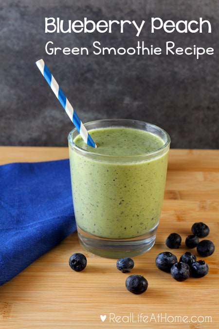Easy to make and full of vitamins and nutrients, this Blueberry Peach Green Smoothie is delicious to drink and sure to please adults and children alike! | Real Life at Home