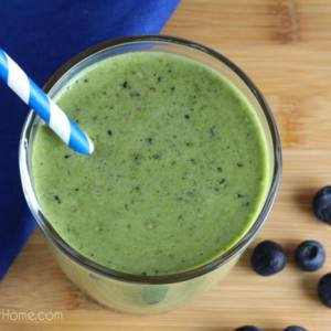 Easy to make and full of vitamins and nutrients, this Blueberry Peach Green Smoothie is delicious to drink and sure to please adults and children alike. | Real Life at Home