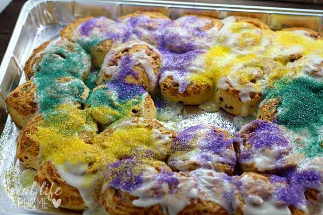 Need a Mardi Gras King Cake but short on time? This recipe, perfect for Fat Tuesday, is a super easy King Cake recipe to make in around 20 minutes.   Real Life at Home