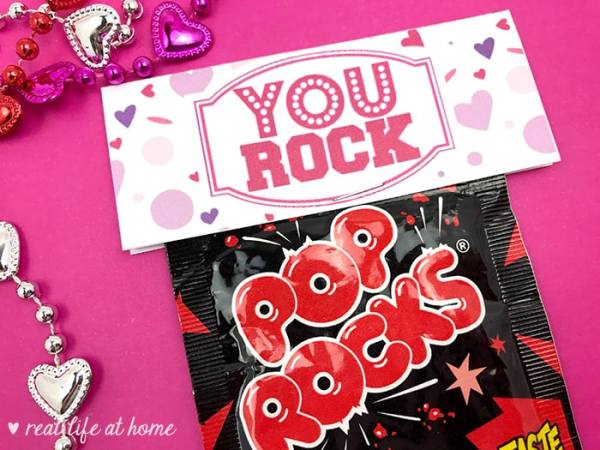 "Need a quick treat bag for Valentine's Day, a class party, a team motivator, or just a little pick me up? Print out this free ""You Rock"" Pop Rocks Treat Bag Topper and attach it to a bag of Pop Rocks, rock candy, chocolate rocks, or a Ring Pop for a quick and easy surprise."