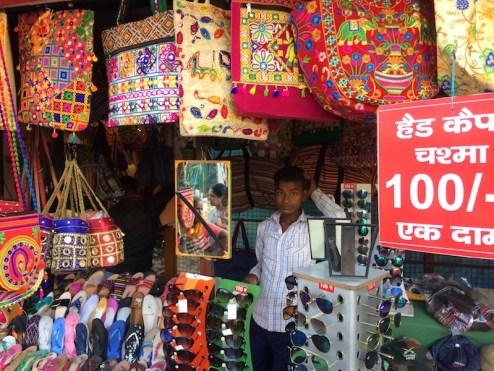 A shop keeper combs his hair. Rishikesh, India