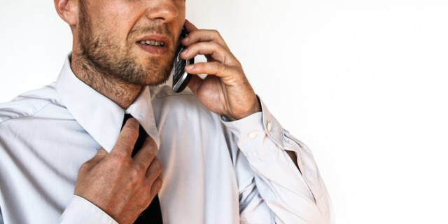 negative body language fidget with tie phone