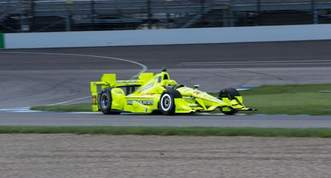 The bright blur of Simon Pagenaud in Turn 2