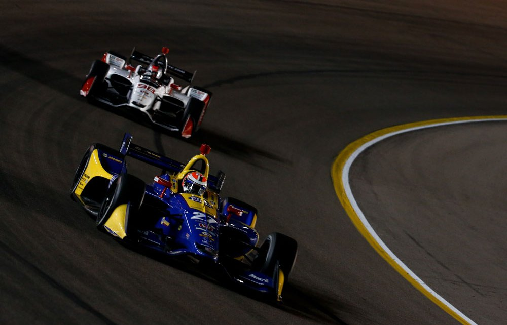 Alexander Rossi and Marco Andretti sail through Turn 1 during the evening open test session at ISM Raceway