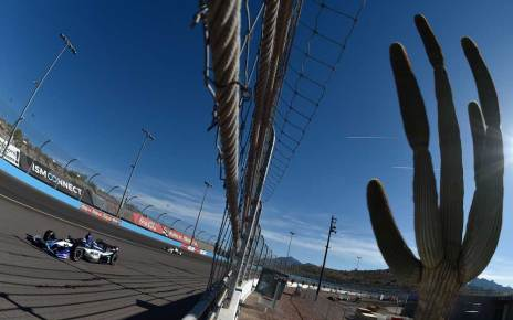 Takuma Sato rolls down the backstretch during the afternoon open test session at ISM Raceway