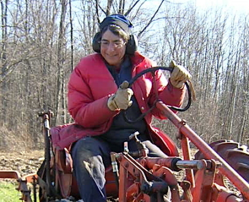 Liz Henderson drives a tractor